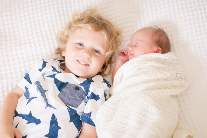 photographing family with your Newborn